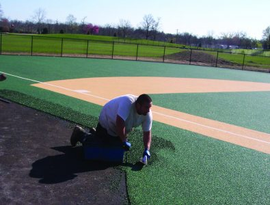 Installing EverTop for Miracle League baseball.