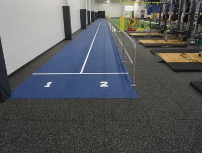 Performance Roll over Performance UltraTiles in fitness facility.