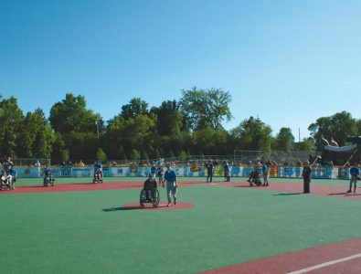 Kids at play on Miracle League baseball field.