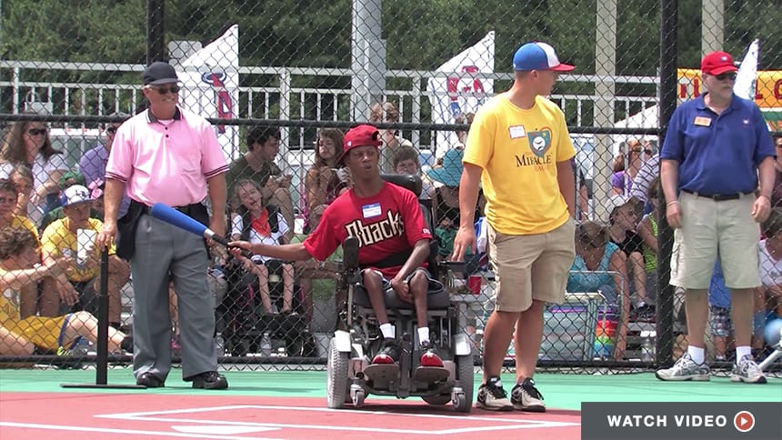 A softball game taking place on a Miracle League field